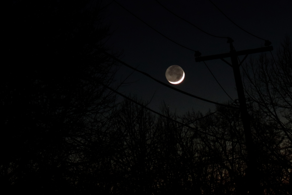 Old Moon in the New Moon's Arms